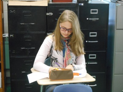 Foreign exchange student Sia Skoryk completes homework in her first period class.