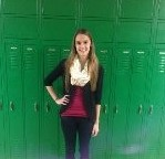 Junior Kristin Beighley wears a black cardigan with a maroon tank and ivory scarf to make the perfect fall look.
