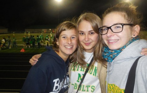 Exchange students Franzi and Emma from Germany huddle with Sia from Ukraine.