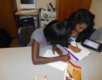 Juniors Akilah Parker and Bethel Aseffa pose as cheaters.