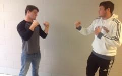 Junior football player Jimi Saul squares off with junior soccer player Mason Reidy .