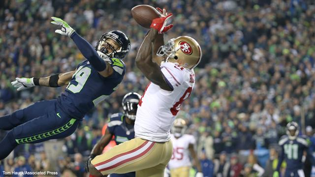 San+Francisco+49ers+wide+receiver+Anquan+Boldin+catches+a+touchdown+pass+over+Seattle+Seahawks+free+safety+Earl+Thomas+during+the+NFC+Championship+playoff+game+between+the+San+Francisco+49ers+against+the+Seattle+Seahawks+on+Sunday%2C+Jan.+19%2C+2014+in+Seattle%2C+WA.+The+Seahawks+and+49ers+will+meet+again+on+Thanksgiving.+Photo+courtesy+of+The+Associated+Press+%28Tom+Hauck%29