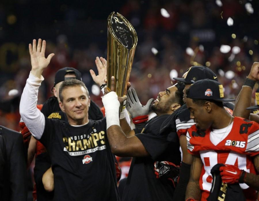 Head+Coach+Urban+Meyer+and+the+Ohio+State+Buckeyes+celebrate+after+beating+Oregon+and+being+crowned+National+Champions+%28Photo+courtesy+of+the+Columbus+Dispatch%29