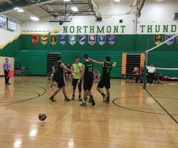 The team celebrates after scoring a point against rivals Centerville. Photo Courtesy of: Northmont Yearbook