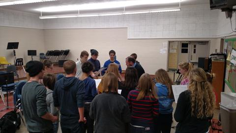 The group rehearses one of their songs.