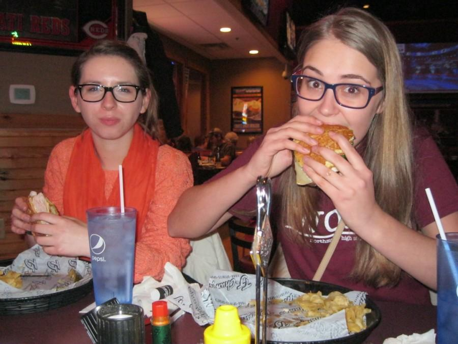 Exchange students Sia Skoryk And Franzi Schuetze enjoy dinner at T.J. Chumps in Englewood.