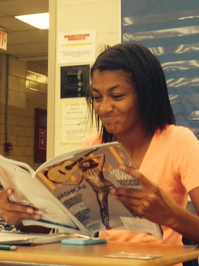 Sophomore Brianna Howard looks at the pages of Elle magazine, which was recently
