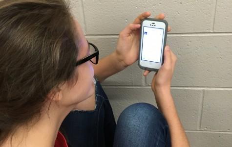 Sophomore Cecelia Stebel reads a tweet that says