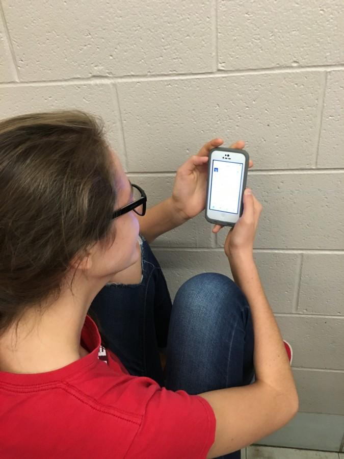 Sophomore Cecelia Stebel reads a tweet that says