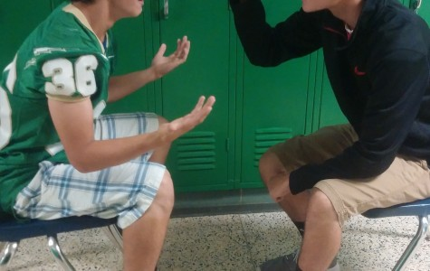Freshmen Rocco Libertini and David Vennemeyer display differing opinions in the hallway, which could quickly become violent if respect is not shown.