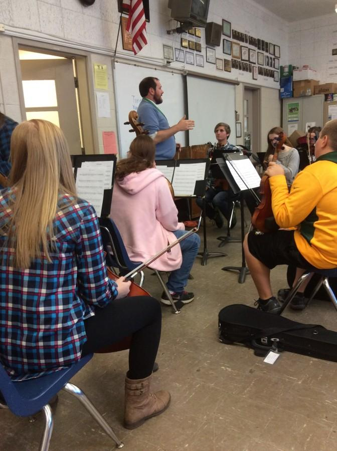 Mr. Ryan Chatterton meets with his fifth period orchestra class in the VMR.
