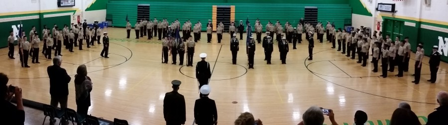 The ROTC unit marches around the gym, going into their ending position, as AMI comes to a close.