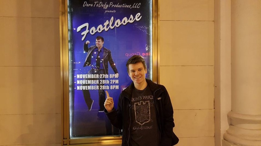 At Victoria Theater in downtown Dayton, senior Eric Thompson points to a poster featuring himself as