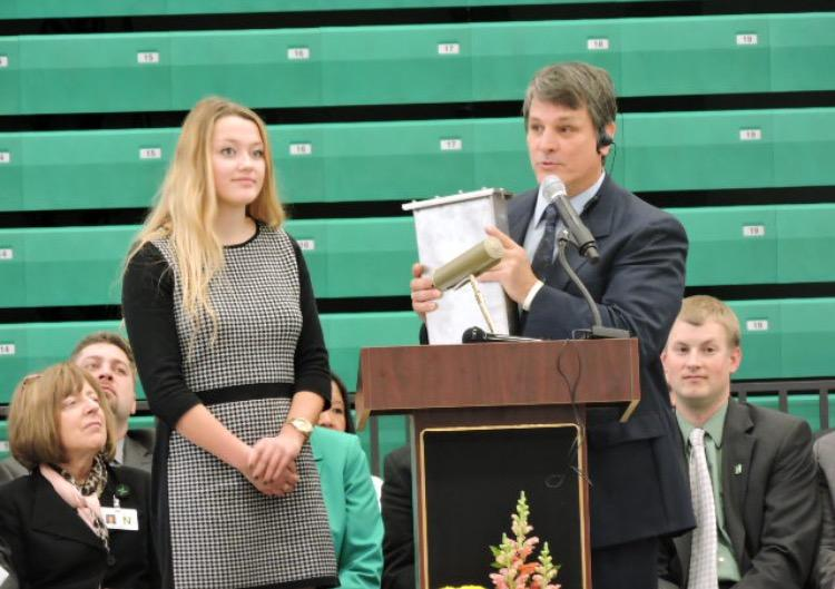 School+Board+Student+Representative+senior+Samantha+Johnson+and+principal+George+Caras+present+the+time+capsule+at+the+dedication+of+the+new+high+school+building+on+January+10%2C+2016.