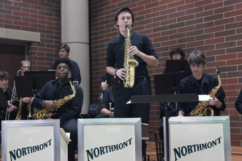 Senior Ian Blouch plays a saxophone solo.