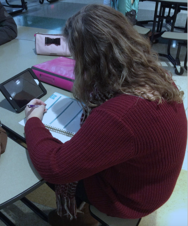 In preparation for scheduling February 16, freshman Delaney Schmidt creates a list of classes she'd like to take next year.
