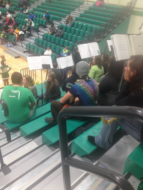 The+band+sits+eagerly+watching+the+game.+