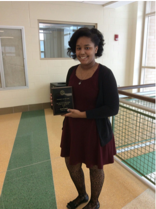 Senior Jaelynn Gordon holds her Rotary Club Student of the Month plaque, awarded on February 9.