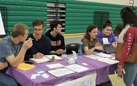Volunteers work the Faithwalk table during the Activity Fair (photo courtesy of Ms. Jenny Wood).