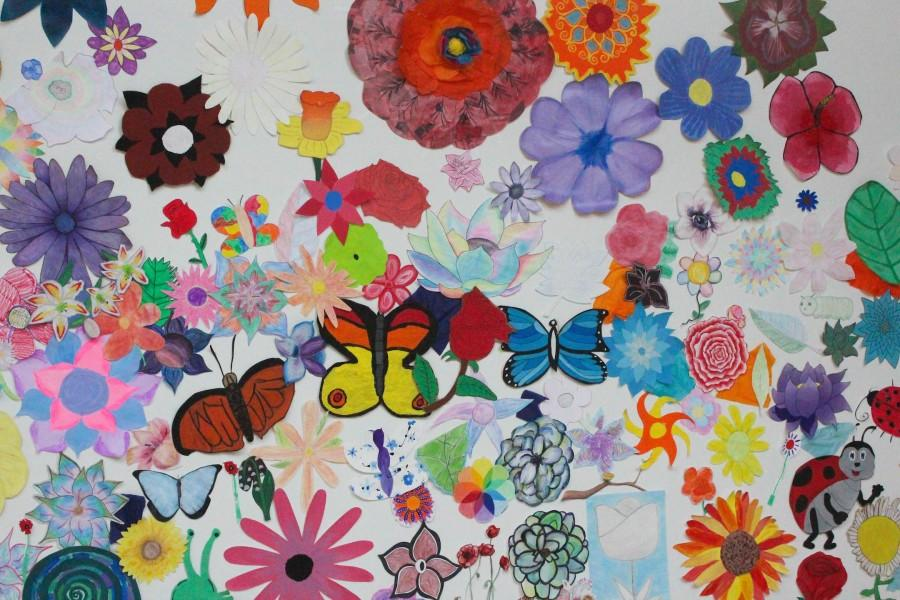 A portion of the Flower Wall, featuring the varied submissions of the students in various art classes