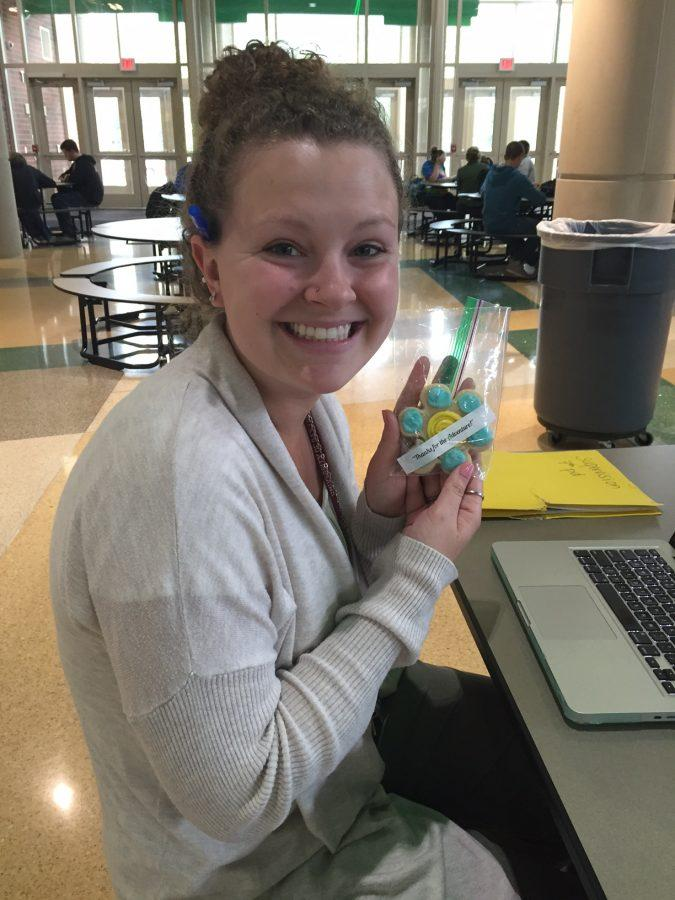 Ms. Theresa Rotuno holds her cookie from Student Government for teacher appreciation week.