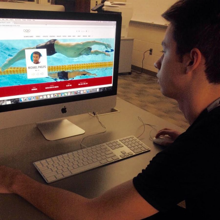 Sophomore Matthew Robertson views Michael Phelps' profile on Olympic.org.