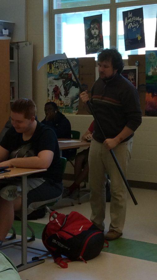 Mr. Ranger Puterbaugh critiques his students work.