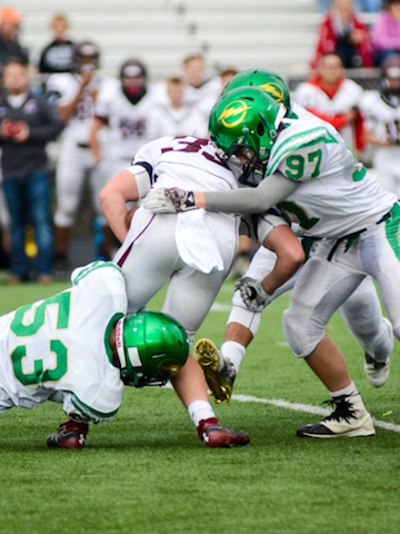 Freshmen Bryce Asher and Nick Henderson make a tackle in their defeat at Butler.