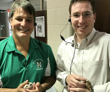 Head Principal George Caras and Assistant Principal Jason Inkrott hold the IMC hamsters