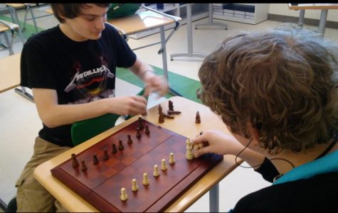 Juniors Dillon Lucente  and Noah Schneider set up the chess board.