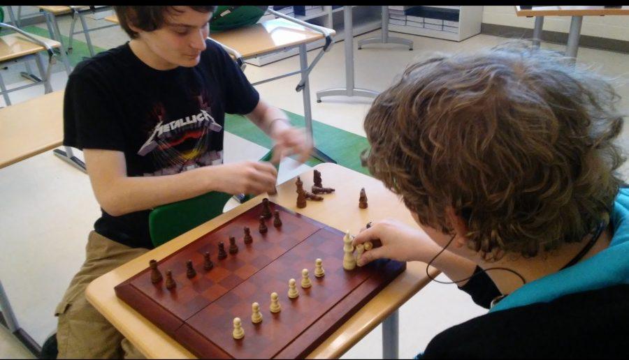 Juniors Dillon Lucente  and Noah Schneider set up the chess board.
