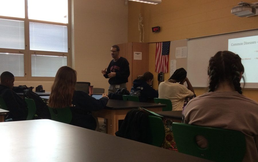 Mr. James Smith speaks to his fourth period class about diseases.