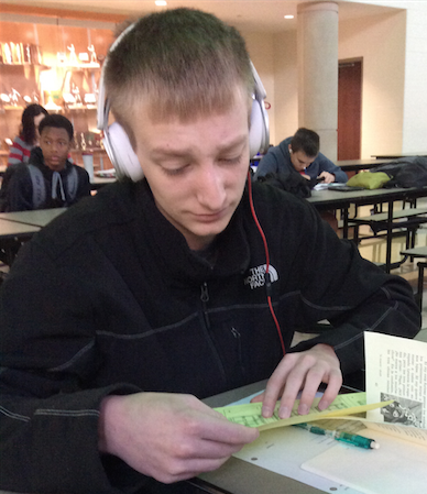 Sophomore Bradlee Fritz examines the misprinted information with confusion.