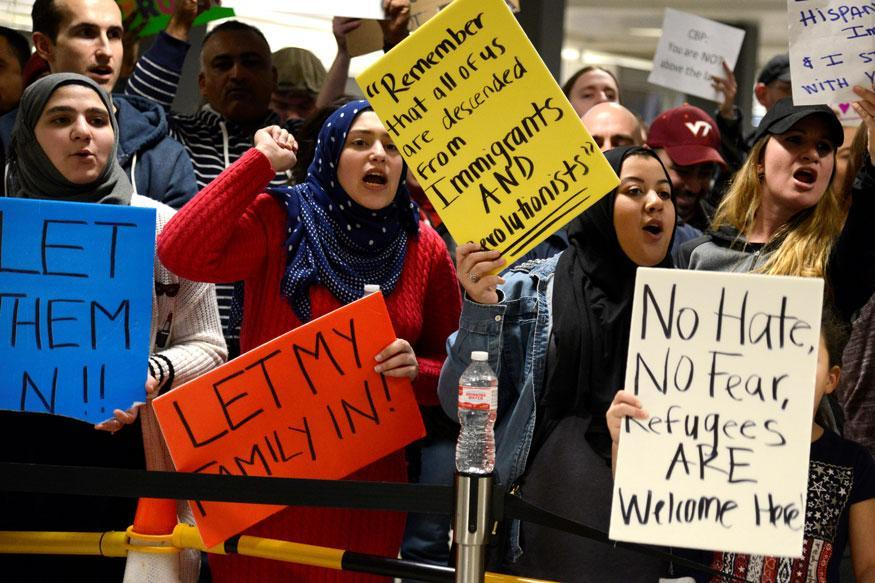 People protest President Trump's immigration order (image courtesy of News18.com).