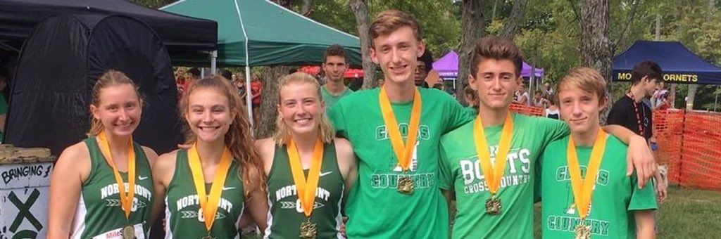 Runners display their medals after the Eaton Invitational (courtesy of Northmont Athletics).