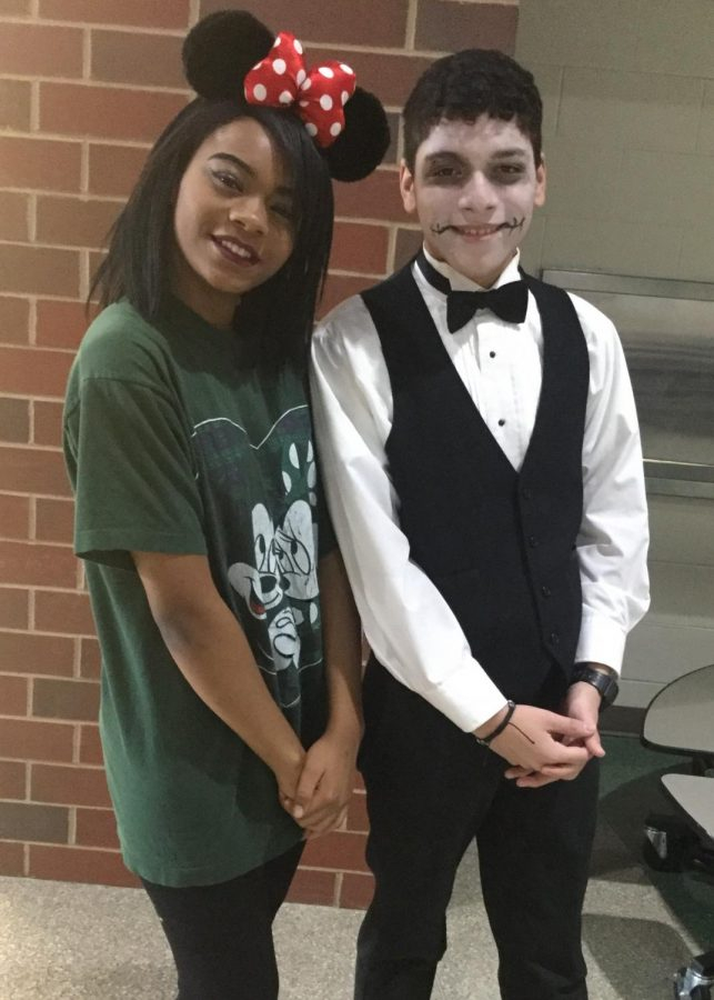 Junior Sasha Spencer and junior Jayson Aguilar dress as Minnie Mouse and a calavera (a Day of the Dead costume) for Costume Day at the high school.