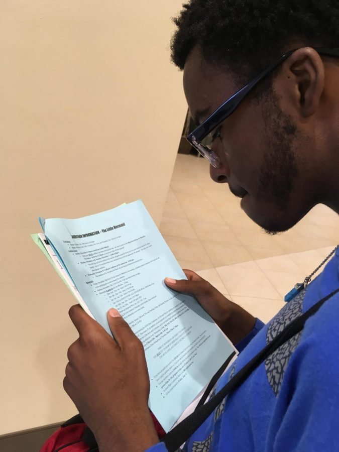 Sophomore Jeffery Rucker reads the information sheet for  Disney's