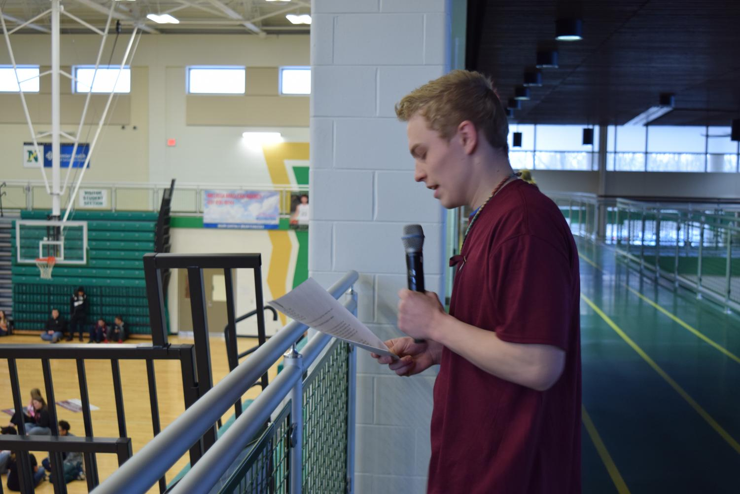 Senior Dominic Stratton addresses his peers at the assembly on March 14.