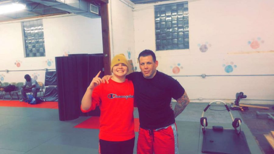Bryce Asher poses with professional UFC fighter Sean Salmon