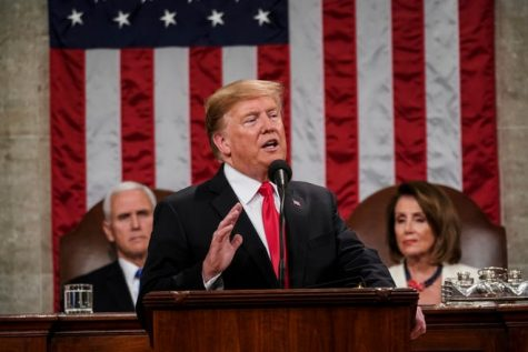 President Trump speaking style his podium (image courtesy of USA Today)