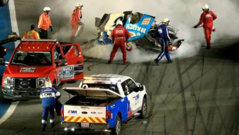 Newman's pit crew extinguishing the flames