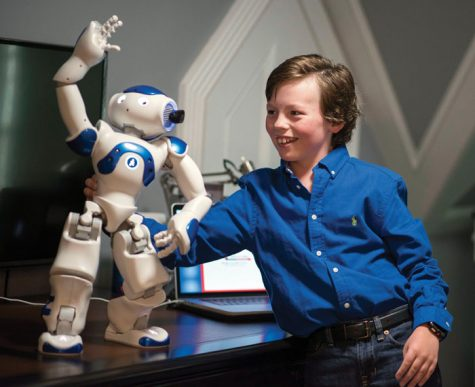 JON C. LAKEY / SALISBURY POST Mike Wimmer helps his Nap Robot Infinite stay balanced as it performs a programmed version of the Thiller dance.  Wimmer, 10-year-old Mensan from Salisbury, recently started his high school career at a CFA Academy in Concord. Wimmer was given the opportunity to give a presentation this past summer at the American Mensa Summer Gathering in Indianapolis with his Nao Robot that he programed for the presentation. .  Salisbury, North Carolina. 10/24/18