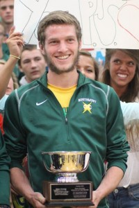 In an assembly held in the Northmont gym, senior cross country runner JT Mackay accepts the honor of being named Penn Station Athlete of the Month.