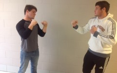 Junior football player Jimi Saul squares off with junior soccer player Mason Reidy .