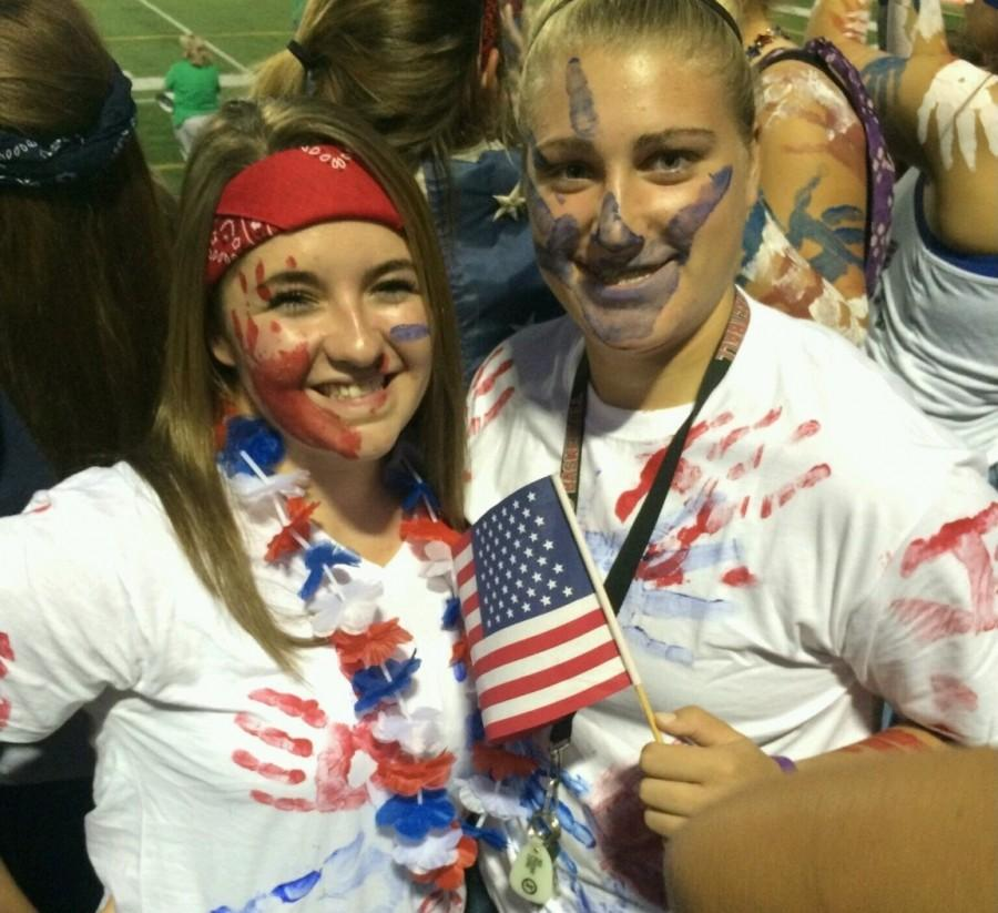Seniors+Shelby+Myers+and+Amanda+Rose+embrace+the+patriotic+theme+at+the+Friday+Night+football+game.
