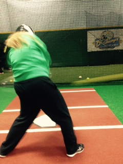 Freshman Anna Fox practices her swing for the upcoming softball season.