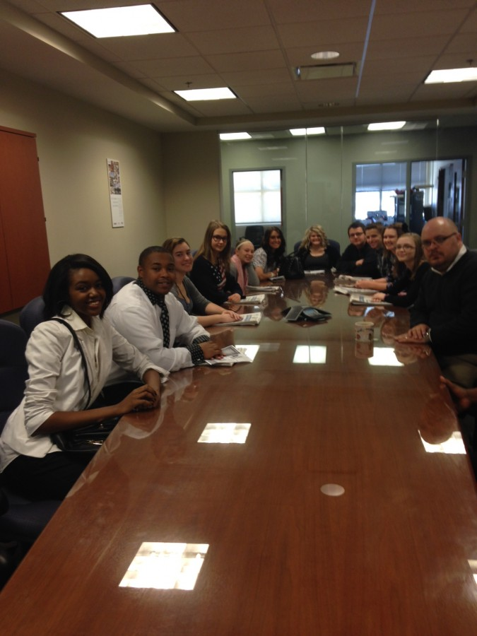 The Surge staff sits in one of the conference rooms to discuss their futures in journalism