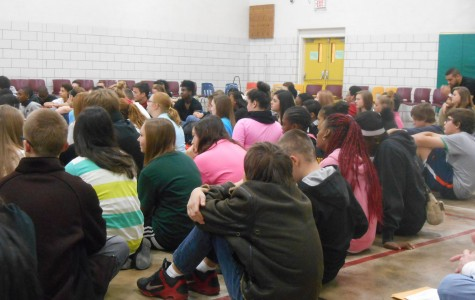 Freshmen sit in the small gym, listening to one of the talks during Unity Day (photograph by senior Amari McCain).