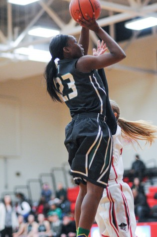 Junior Denissa Sly takes a jump shot (Photo courtesy of Northmont Yearbook)