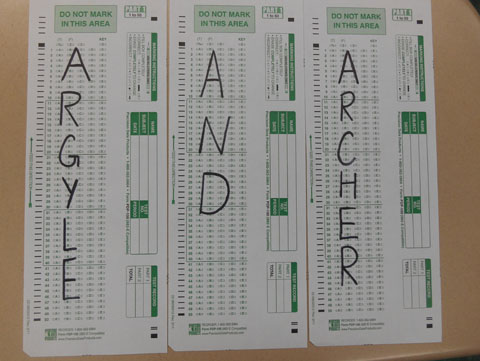 Argyle and Archer showing students how to take exams.